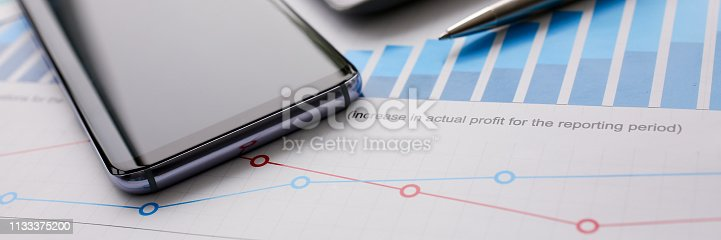 istock Silver calculator with gray keyboard is lying 1133375200