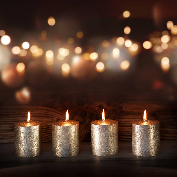 silver candles in front of a festive background - trauer abschied tod stock-fotos und bilder