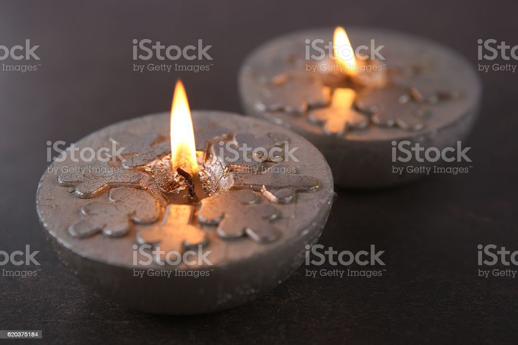 Silver  candles  with snowflakes. zbiór zdjęć royalty-free