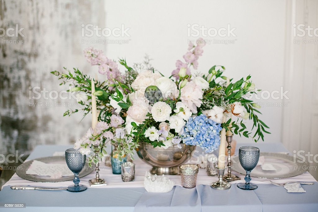 Silver candlestick and other elements of festive table wedding decorations. stock photo