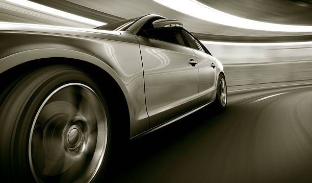 Silver car speeding in tunnel 3d rendering of a brandless generic car of my own design in a tunnel with heavy motion blur sports car stock pictures, royalty-free photos & images