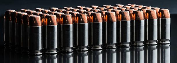 Silver Cased 45 Auto Handgun Ammunition stock photo