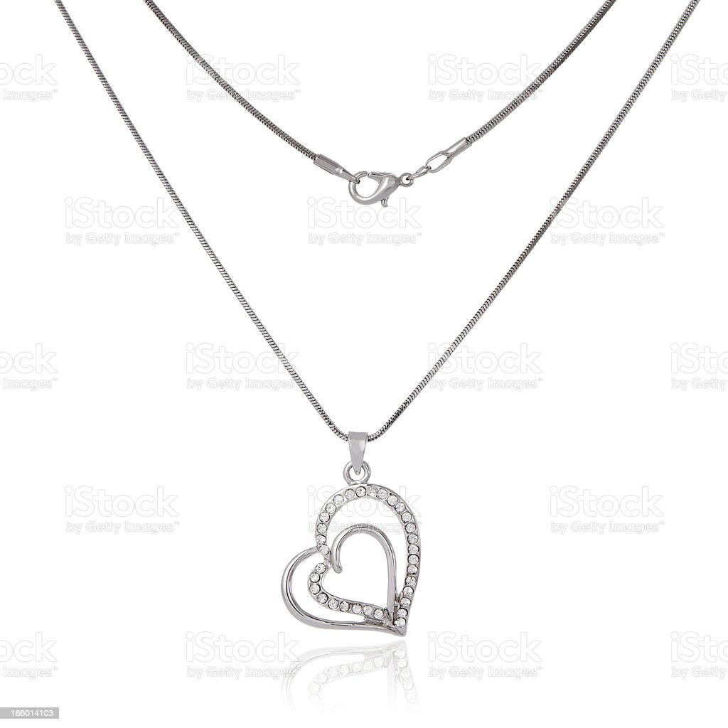 Silver chain and pendant in the shape of heart stock photo