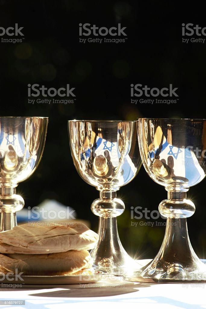 Silver chalices with the flag of Israel stock photo