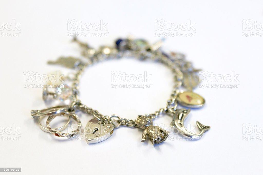 Silver charm bracelet (selective focus) stock photo