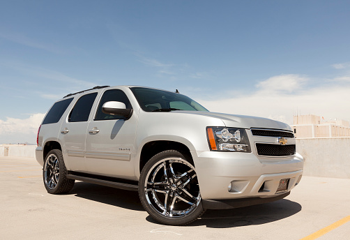 Scottsdale, United States - August 18, 2011: A photo of a silver Chevrolet Tahoe sport utility vehicle. The Tahoe is a very popular SUV in the United States.