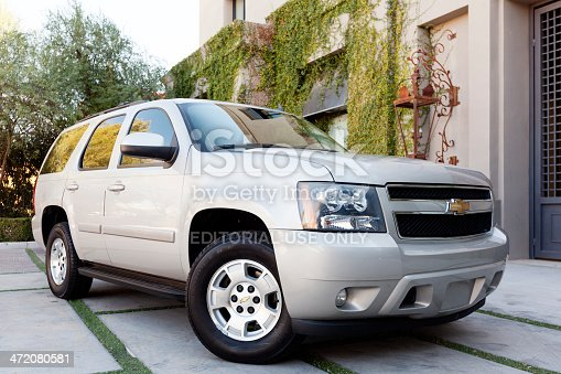 Scottsdale, United States - February 4, 2012: A photo of a silver Chevrolet Tahoe sport utility vehicle. The Tahoe is a very popular SUV in the United States.