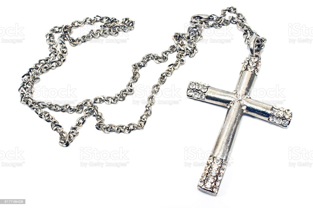 Silver christian cross necklace isolated on white stock photo
