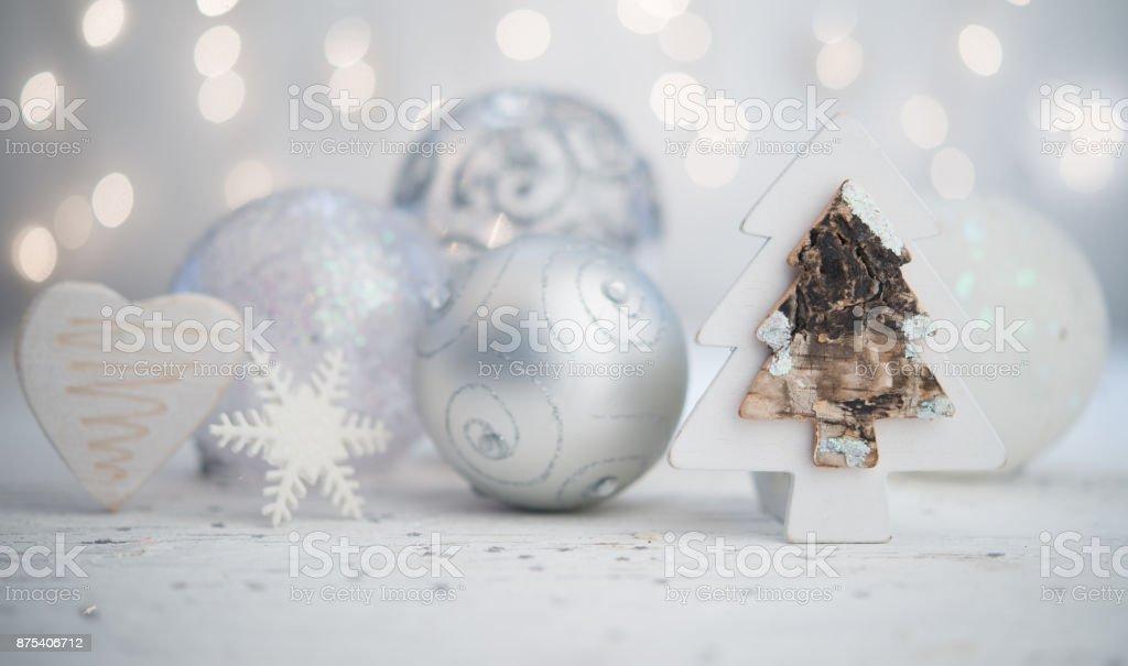 Silver Christmas balls with tre heart adn snowflake stock photo