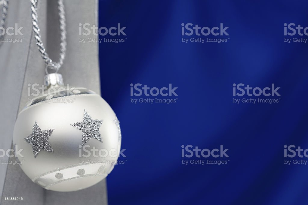 silver christmas bauble with blue background royalty-free stock photo