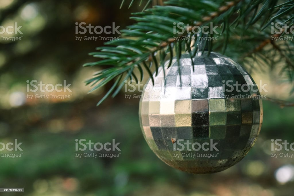 Silver Christmas Ornament Hanging on a Pine Tree Branch stock photo