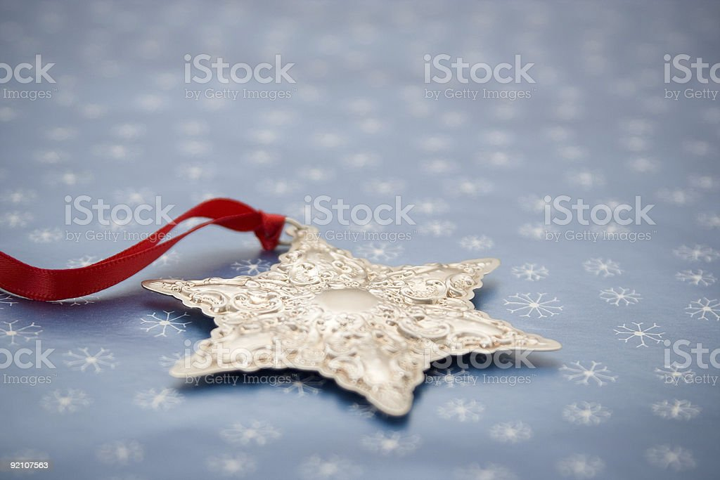Silver Christmas Ornament on Snowflake Background royalty-free stock photo