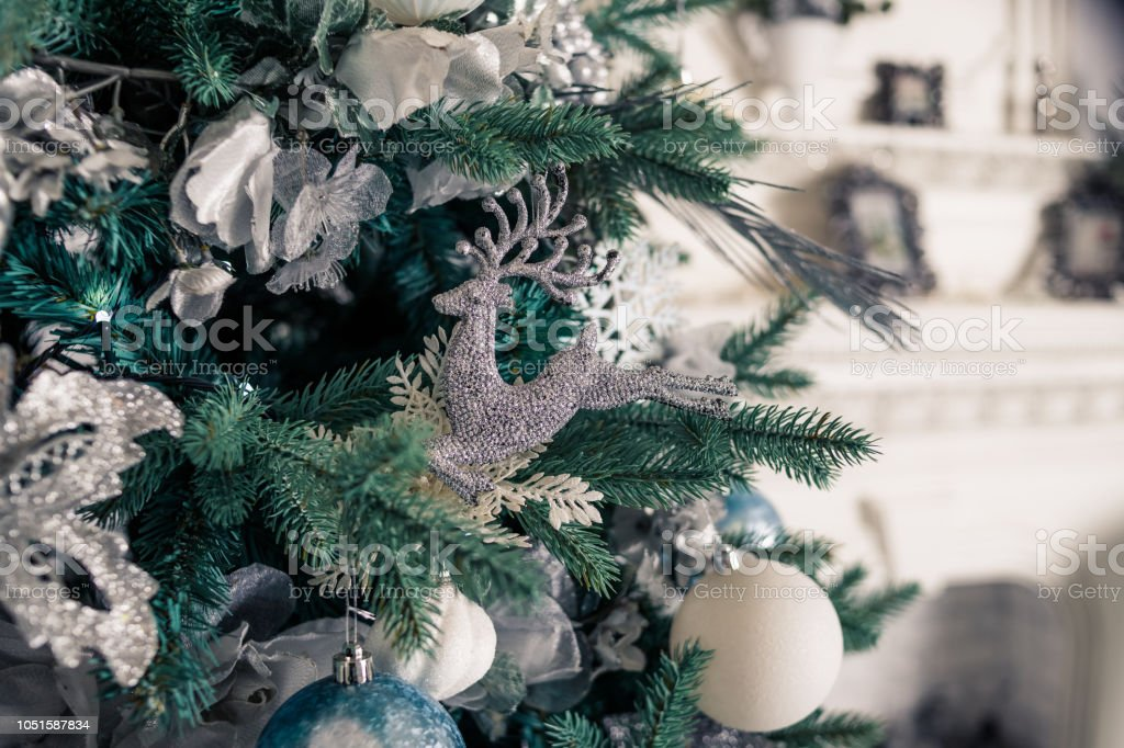 Expensive Christmas Ornaments.Silver Christmas Ornaments Hanging On Fir Treesection Of A