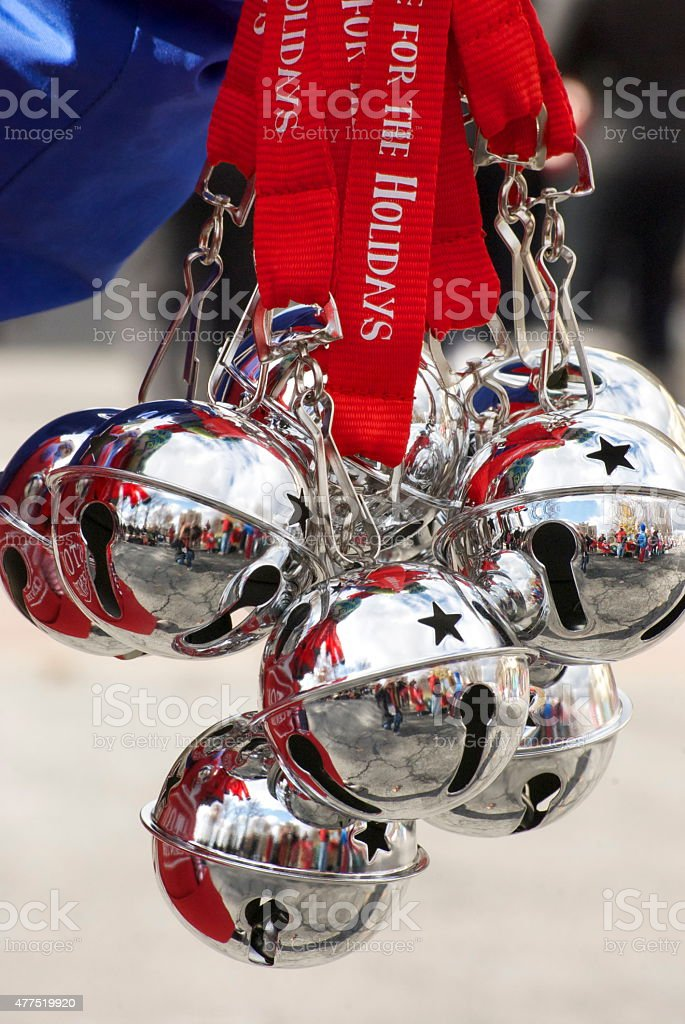 Silver Christmas Sleigh Bells Hanging From Red Ribbons. stock photo