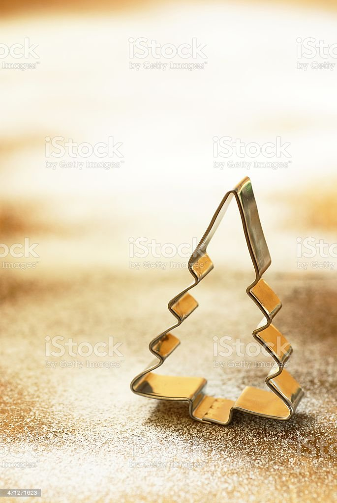 Silver Christmas tree baking cutter royalty-free stock photo
