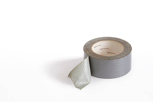 Silver Cloth Duct Tape Roll for Repairing Anything Roll of gray adhesive duct tape on white background.  terryfic3d stock pictures, royalty-free photos & images