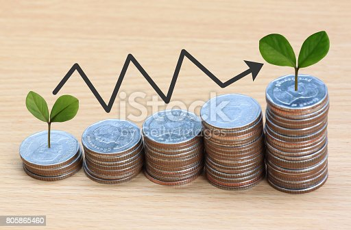 istock Silver coin stack and arrow line and have treetop in business growth concept on wood floor. 805865460