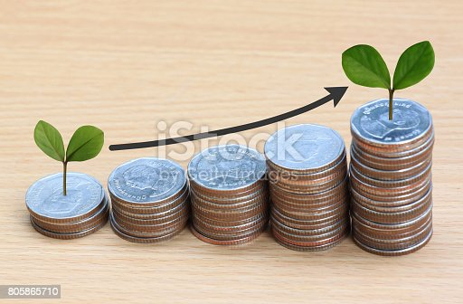 istock Silver coin stack and arrow line and have treetop in business growth concept on wood floor. 805865710