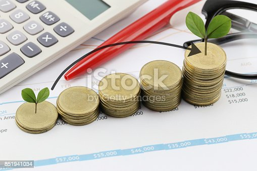 istock Silver coin stack and arrow line and have treetop in business growth concept on paper of report assessed income. 851941034