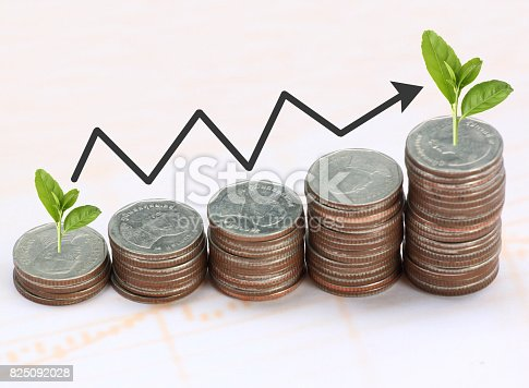 istock Silver coin stack and arrow line in business growth concept on paper background. 825092028