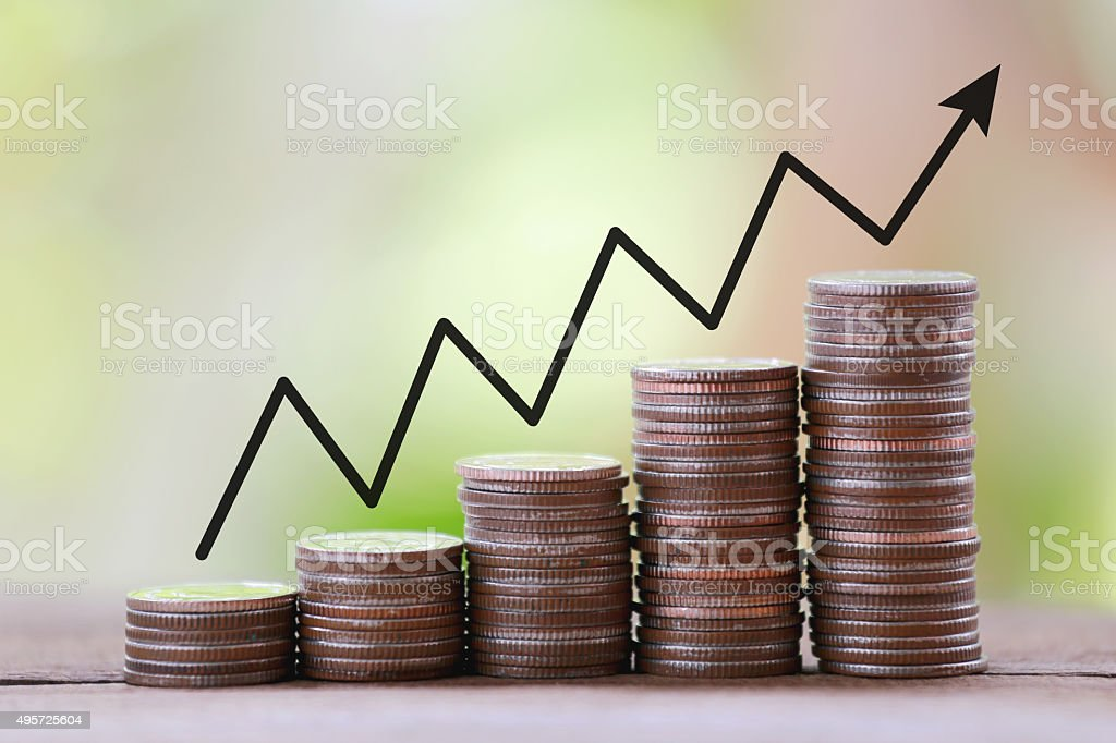 silver coin stack and arrow line in business growth concept. stock photo