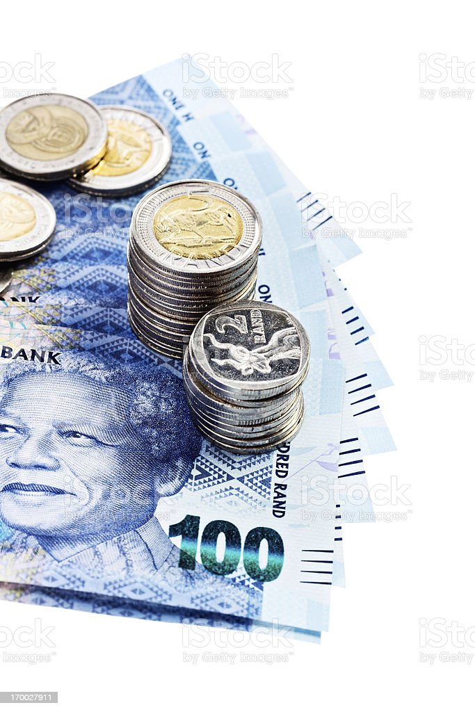 Silver coins hold down new South African banknotes featuring Mandela stock photo