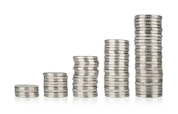 silver coins stacks - coin stock photos and pictures