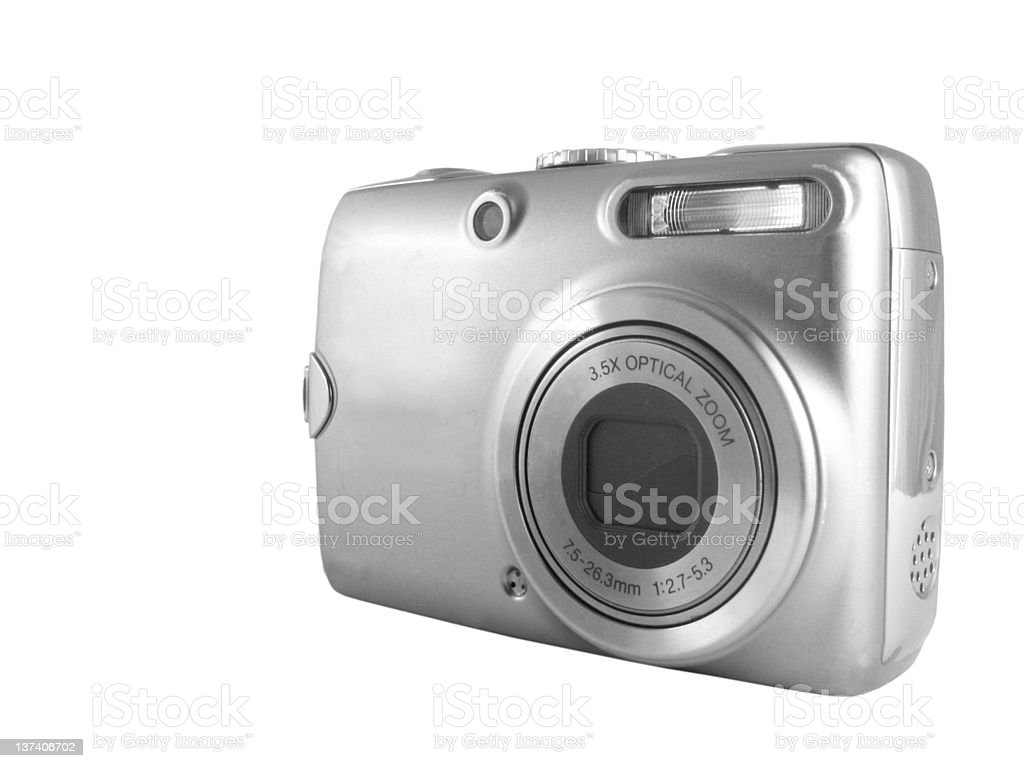 Silver colored digital camera on white background stock photo