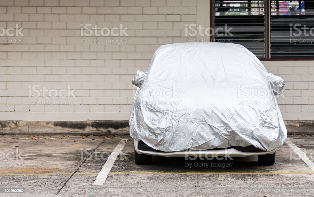 Silver cover for new car stock photo