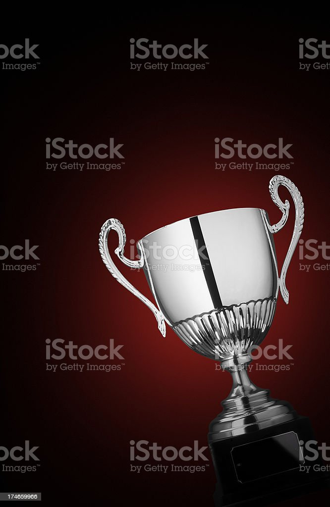 Silver cup on red background with copy space royalty-free stock photo