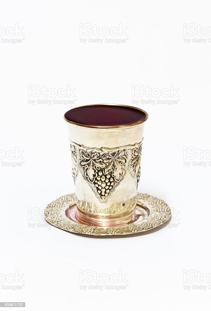 Silver cup with red wine stock photo