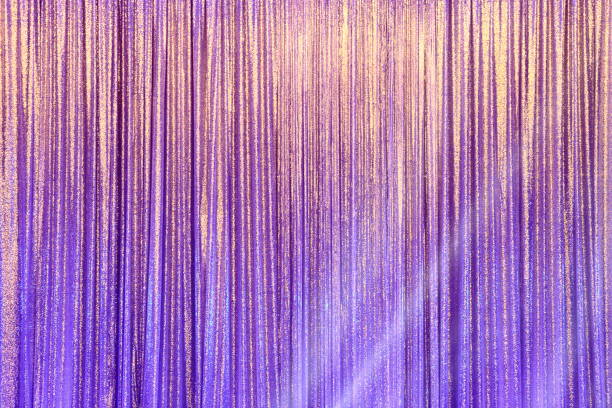 Silver Curtain Screen drape wave and lighting beam stock photo