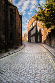 istock Silver curved cobbled street leads to historic Durham Cathedral 186136338