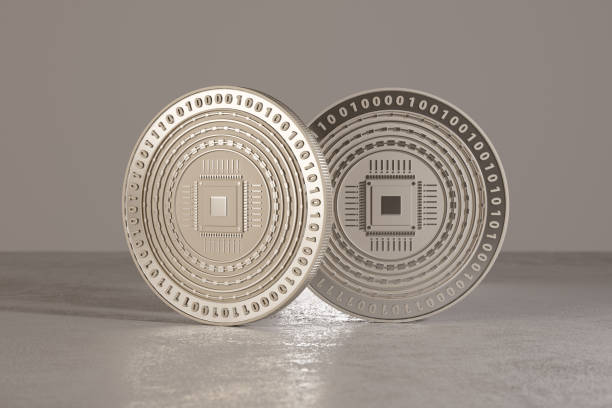 Silver digital crypto-currency coins standing on metal floor stock photo