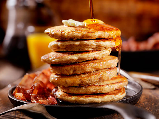 silver dollar pancakes with maple syrup - maple syrup stock photos and pictures