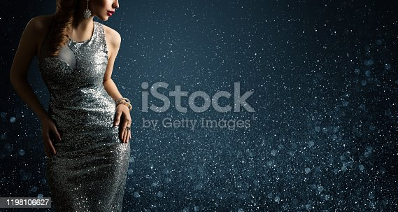 Silver Dress, Fashion Model Posing in Sparkling Sexy Gown, Woman Beauty Portrait on Lighting Sparkles Background