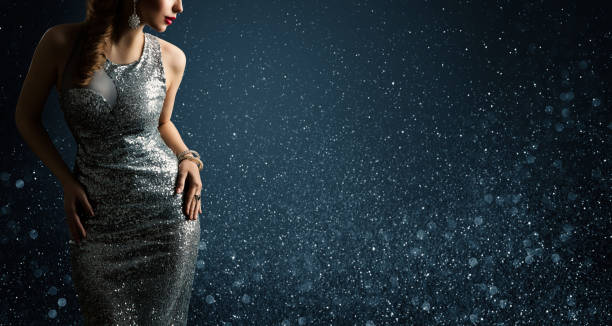 Silver Dress, Fashion Model Posing in Sparkling Sexy Gown, Woman Beauty Portrait stock photo