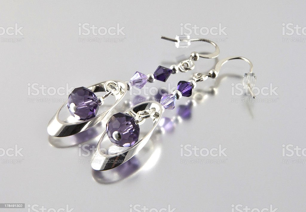 Silver earrings royalty-free stock photo