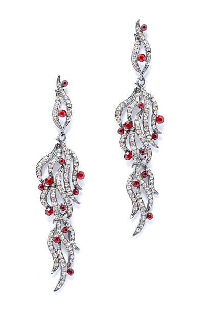 silver earrings with red stones on white background - ohrringe tropfen stock-fotos und bilder