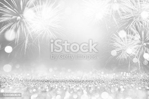 istock Silver Fireworks and grey bokeh in New Year eve and space for text. Abstract background holiday 1044960626