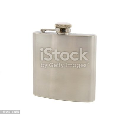 istock Silver flask of brandy isolated over a white background 468411439