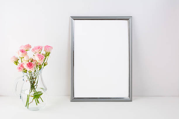 Silver frame mockup with pink roses stock photo