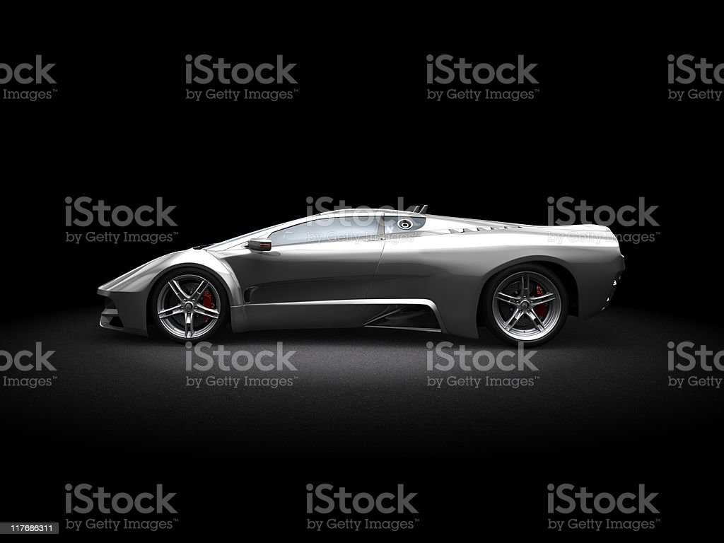 Silver futuristic-looking sports car on dark background stock photo