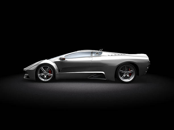 Silver futuristic-looking sports car on dark background 3D Rendering image showing a concept design made by my own. This is one image out of a series with different angles. Silvermetalic supersport car on dark background. This is the perfect stuff for people how need race cars, supersport cars without any manufacture brand.  exoticism stock pictures, royalty-free photos & images
