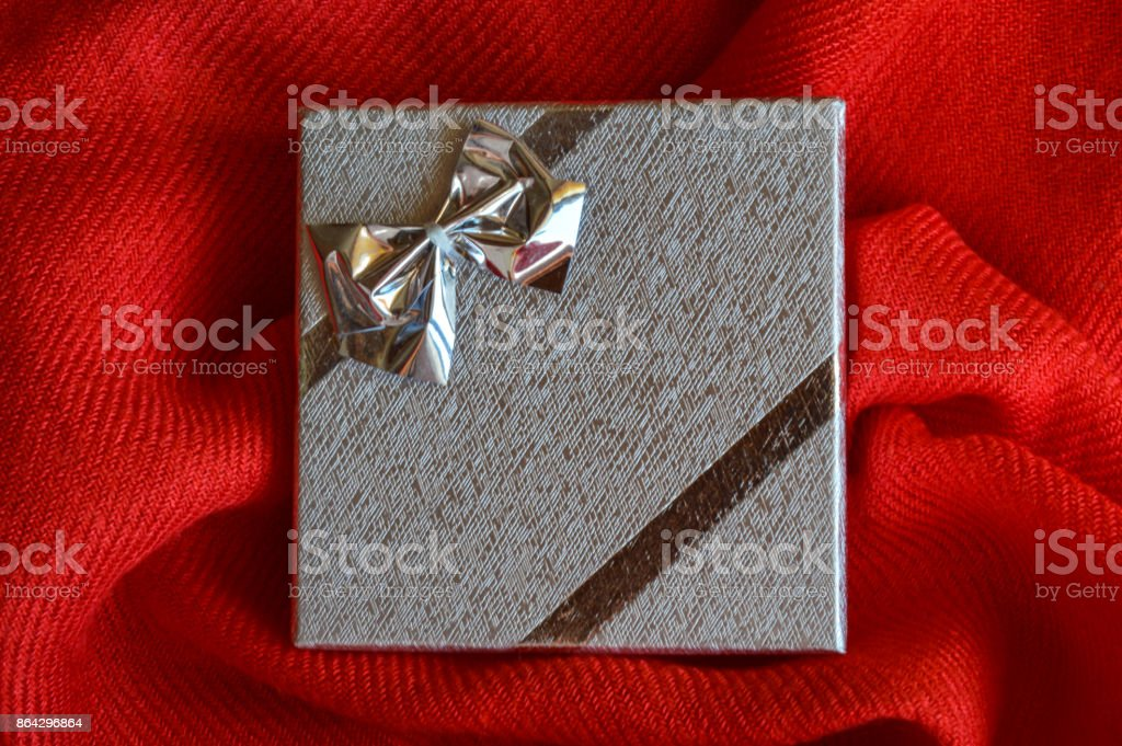 A silver gift box with a bow royalty-free stock photo