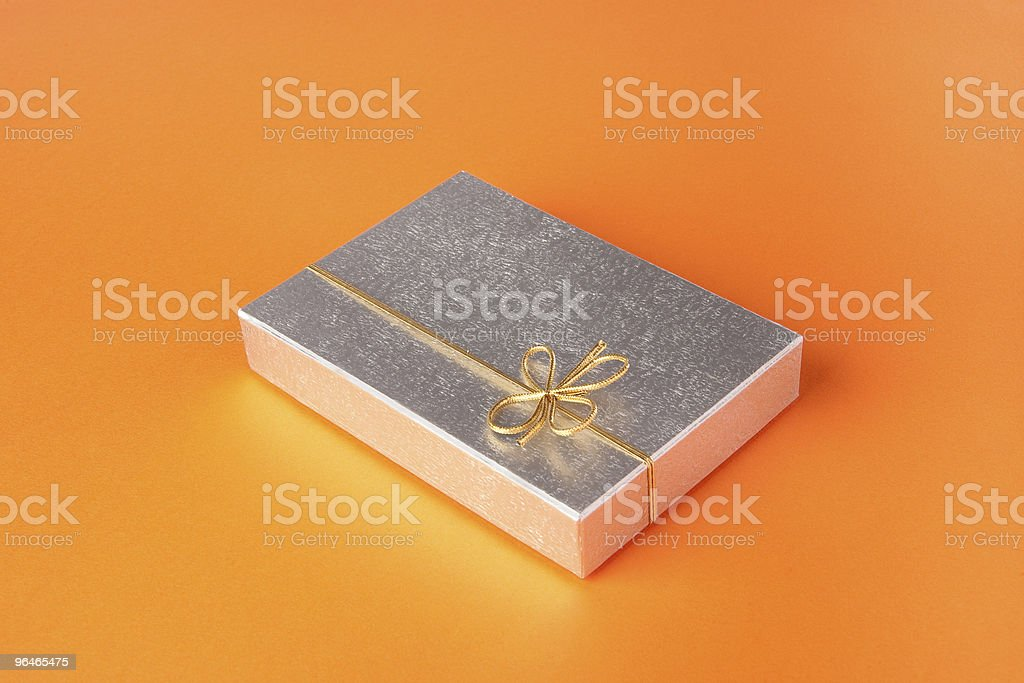 Silver gift box with gold ribbon royalty-free stock photo