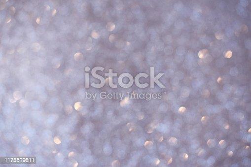 866754590 istock photo Silver gliter bokeh lights blured 1178529811