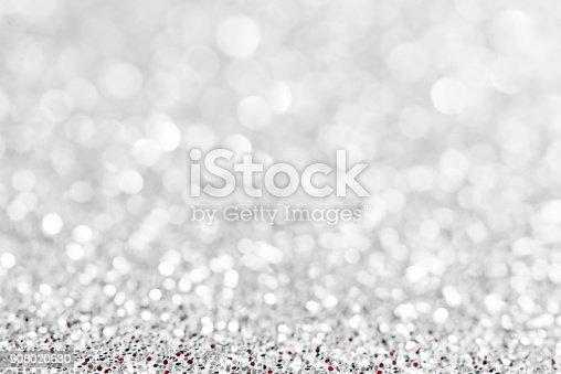 866754590 istock photo silver glittering background 908020630