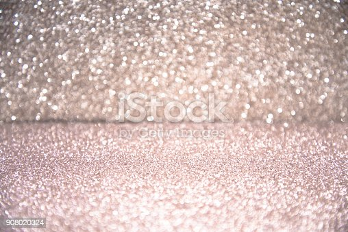 866754590 istock photo Silver glittering Christmas lights. Blurred abstract background 908020324