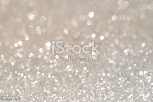 istock Silver glittering christmas lights. Blurred abstract holiday background 657220460